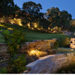 Texas Outdoor Lighting added up lights to showcase this sculpture at this home in Barton Creek Texas