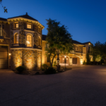 Up lights highlight the stone exterior on a home in Austin Texas